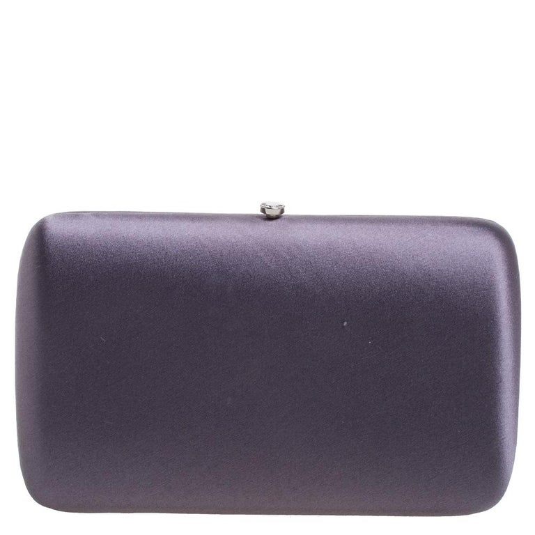 Everybody loves chic accessories that come with an edge. From the house of Prada comes this gorgeous box clutch that will perfectly complement all your outfits. It has been crafted from stunning purple-hued satin and silver-tone metal and styled