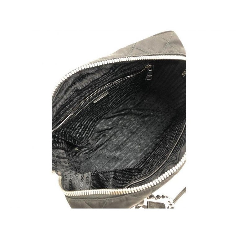 Great bag by Prada in quilted Nylon. The silver hardware next to the nylon just pops put. Wear on the shoulder, handhold or wear on the crook of the arm. A preloved bag in very good condition.  BRAND Prada  ACCESSORIES Autehnticity card, Dust bag,