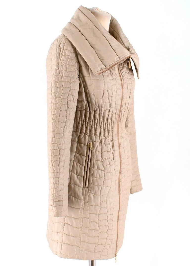 Prada Quilted Silk Midi-Length Coat £1390 RRP  - Snake Effect Quilted Design - External Side Zip Pocket  - Fold Down Collar  - Front Zip Fastening  - Gold Tone hardware - Midi Length   Made in Italy   Please note, these items are pre-owned and may