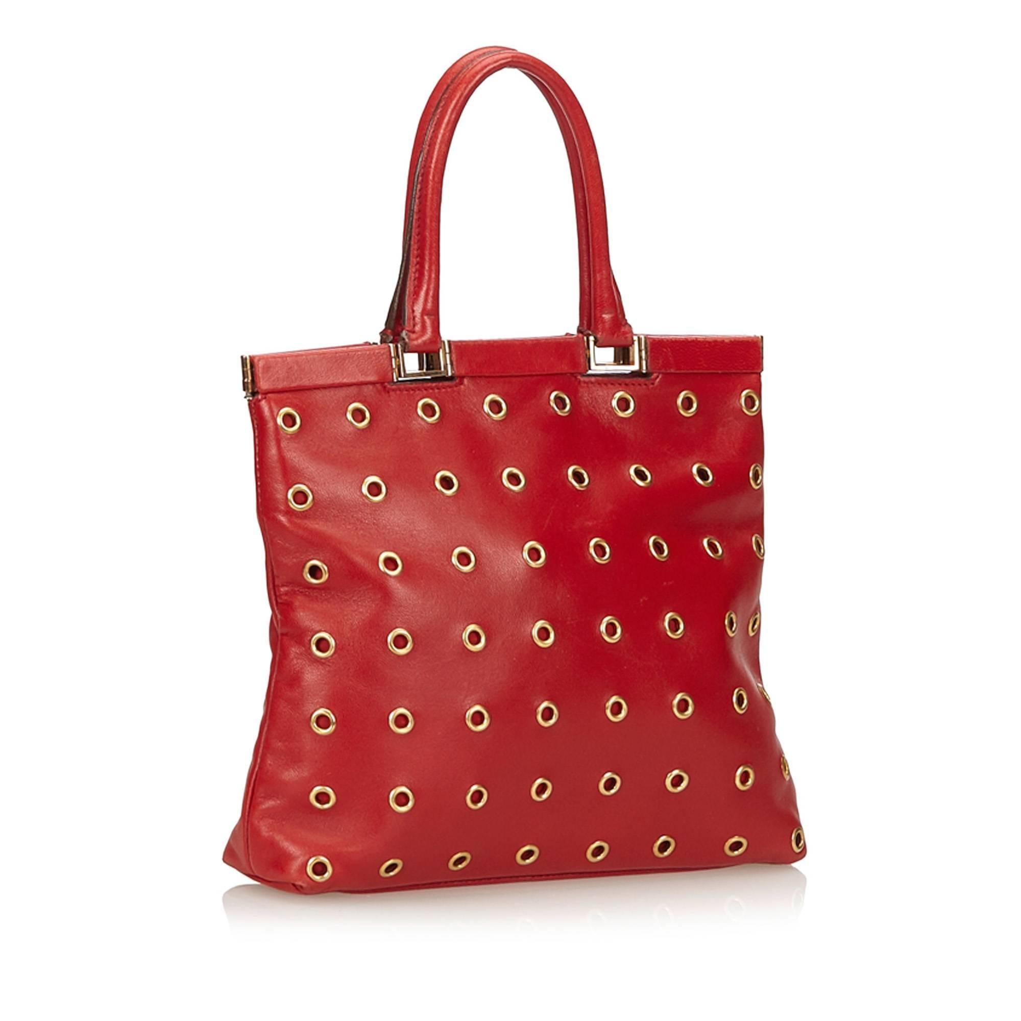 Prada Red Calf Leather 18 Carat Gold-Toned Eyelet Handbag For Sale at  1stdibs 047f89cbaf26d