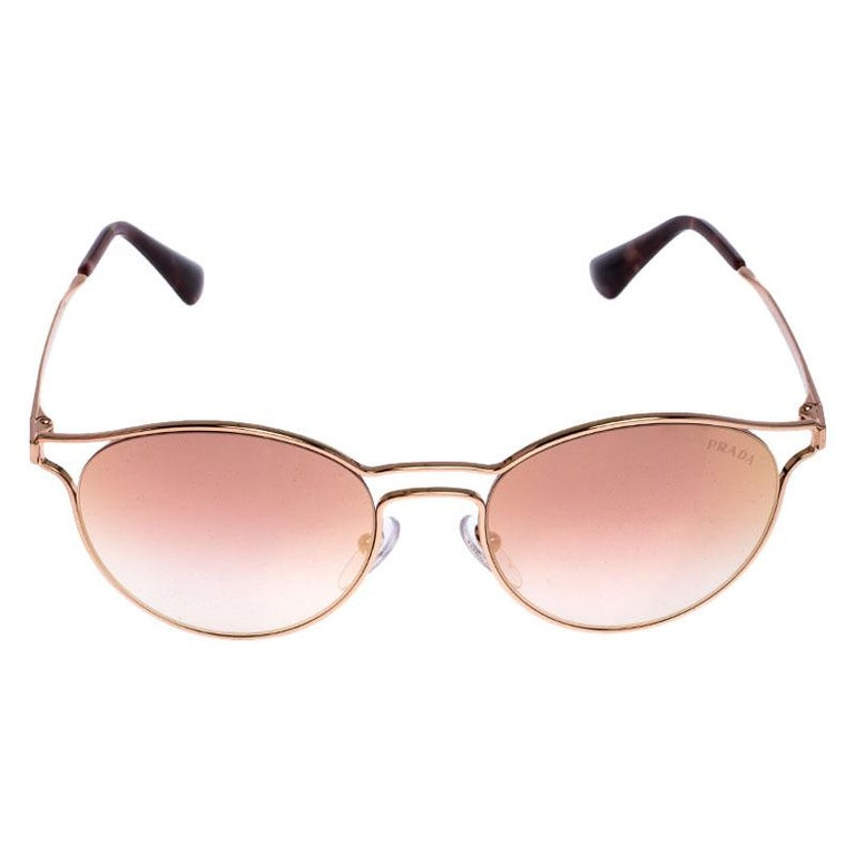 If statement pieces are your thing then this pair of sunglasses from the house of Prada is one you need to own! Smartly designed to mirror a fashionable look, these sunglasses have a classy appeal to add the luxe hint to your look.  Includes: