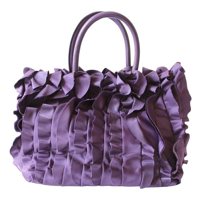 Beautiful Prada bag Year 2008 Fabric Purple color Rouches Double handle Automatic button closure Two internal zip pockets Cm 33 x 22 x 14 (12.9 x 8.6 x 5.5 inches) Worldwide express shipping included in the price !