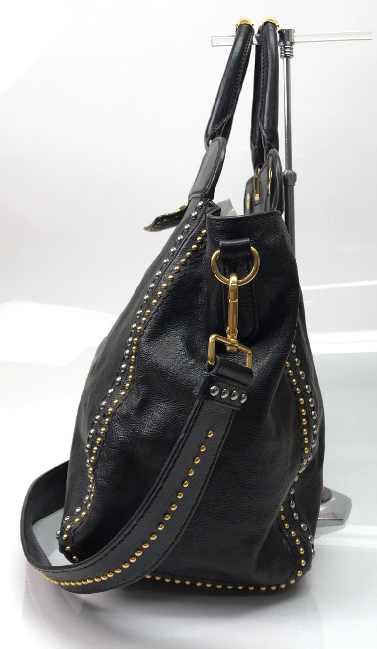 PRADA Runway Black w/ Gold&Silver Studded Large Tote. This amazing Prada tote is in great condition. It has minimal sign of use that is consistent with age. It is made of black leather with gold and silver studs throughout. There is a black leather