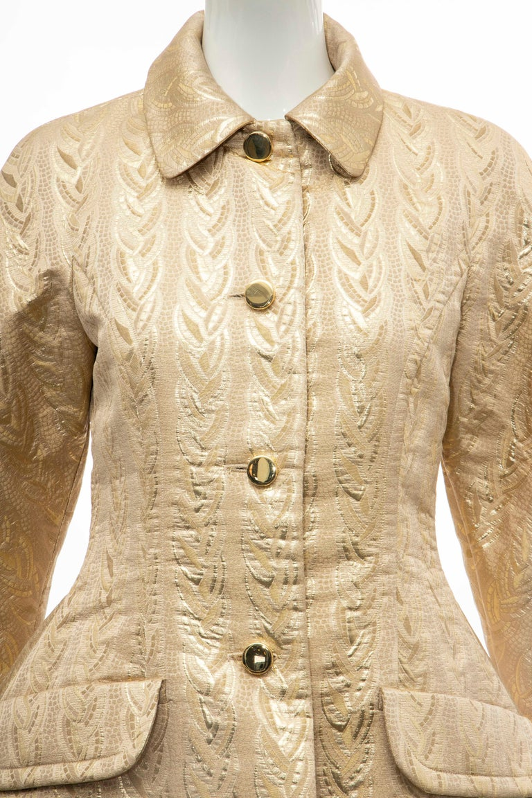 Prada, Fall 1992 runway gold brocade jacket, dual flap pockets at waist, button closures at center front and fully lined.   Bust: 33, Waist: 29.5, Shoulder: 16, Length: 26.5, Sleeve: 27.5  Fabric: 60% Acetate, 40% Cupro