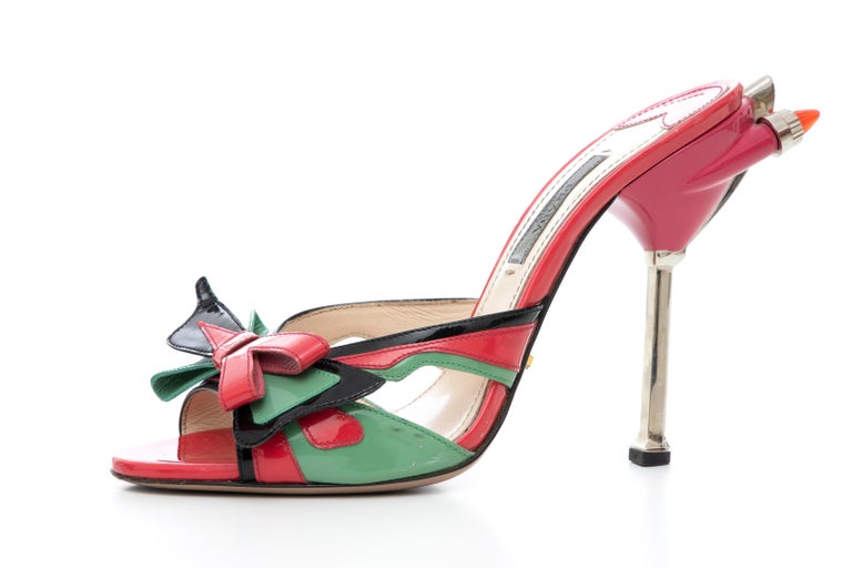Prada, Spring-Summer 2012, patent leather Hot Rod slide sandals with bow accents at uppers and tail light embellishments at heels.  Heels: 5  IT. 37.5 US. 7.5