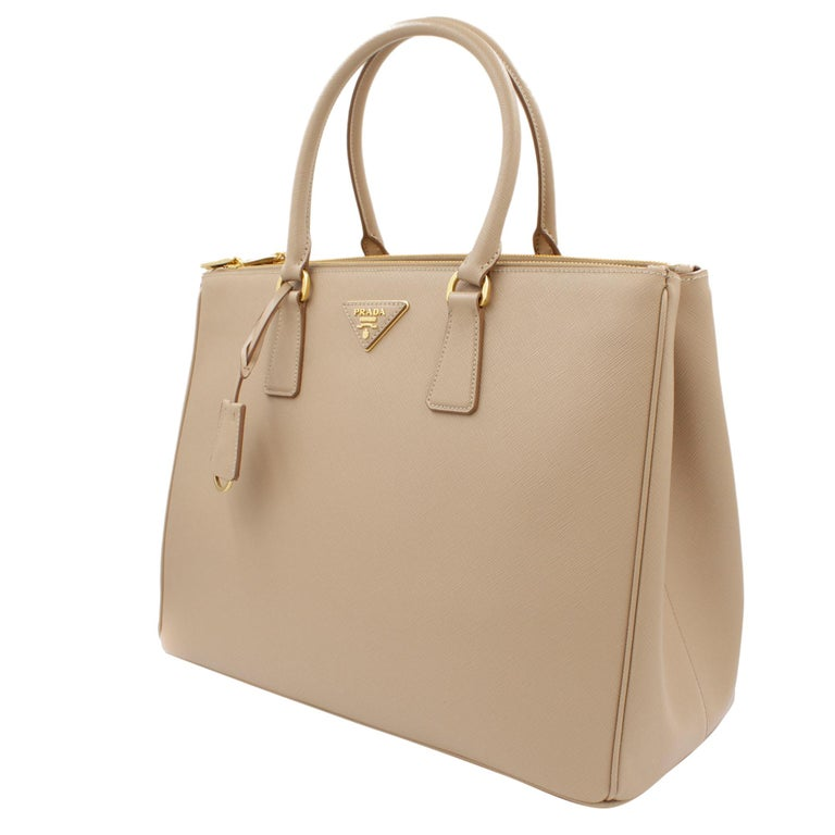 3f5a95d3dcc8 Prada's Galleria saffiano tote is a perfectly prim addition to your  accessories edit. Crafted from