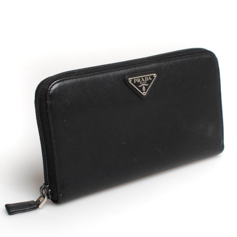 Classic PRADA saffiano leather zip travel wallet in black.