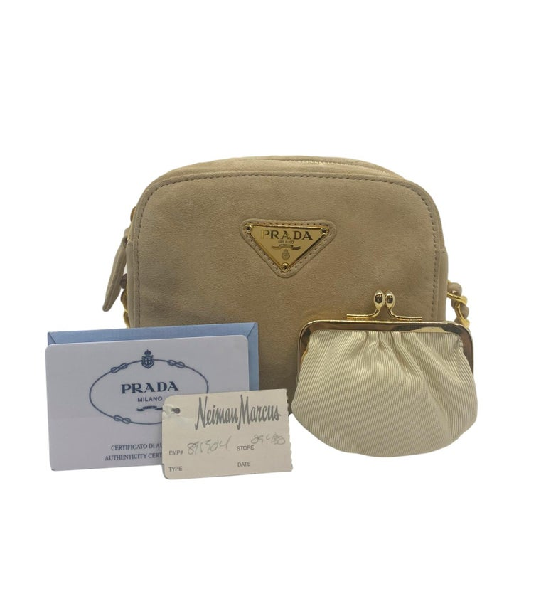 Prada Sand Suede Leather Vintage Mini Crossbody Bag, 2005. Founded by Mario Prada in 1913, Prada's flagship location opened in the Galleria Vittorio Emanuele II in Milan, the world's oldest shopping mall. By 1919, Prada officially became the