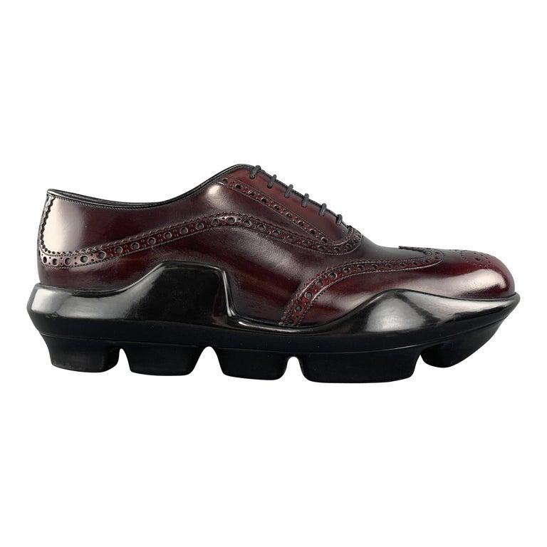 PRADA Size 10 Burgundy Leather Wingtip Rubber Platform Sole Lace Up For Sale