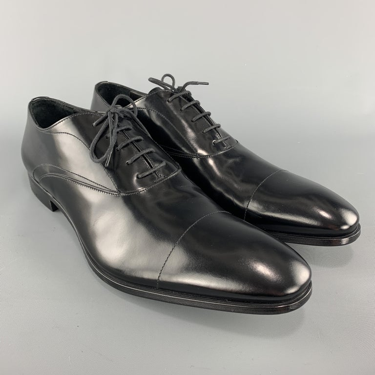 PRADA dress shoes come in polished black leather with a pointed cap toe. Never worn. Made in Italy.  Brand New.  Marked: UK 10.5  Outsole: 12.75 x 4.25 in.