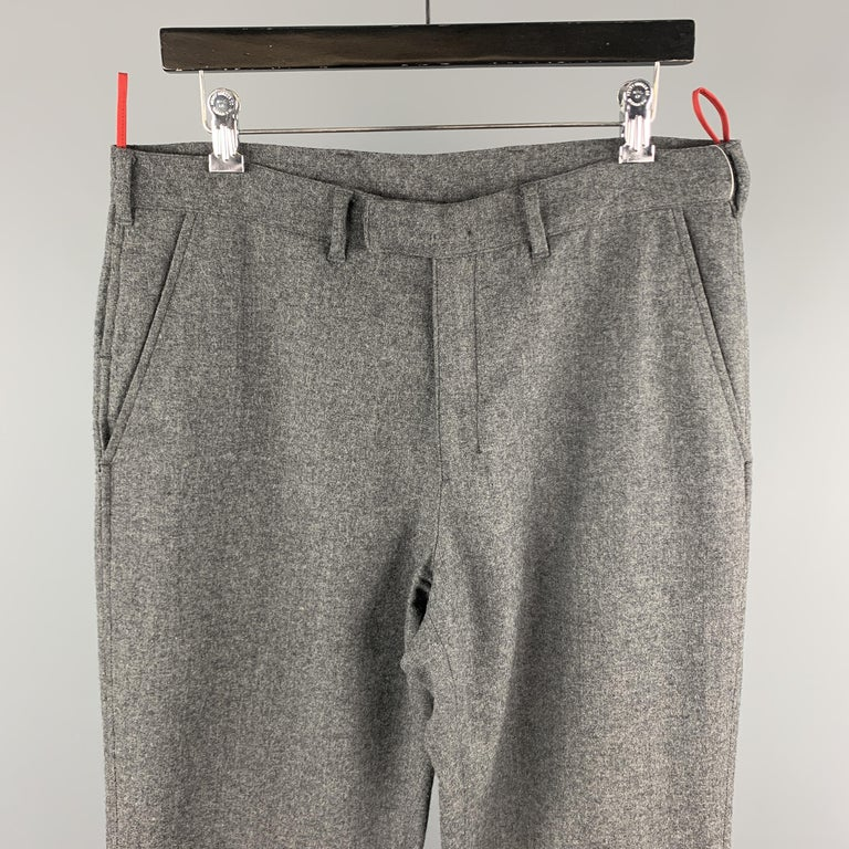 PRADA casual pants comes in a gray wool blend featuring a regular fit, front tab, and a zip fly closure. Made in Italy.    Excellent Pre-Owned Condition. Marked: IT 50  Measurements:  Waist: 34 in.  Rise: 10 in.  Inseam: 34 in.