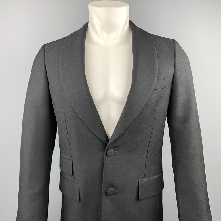 PRADA sport coat comes in a black wool / mohair featuring a shawl lapel style, flap pockets, and a two button closure. Made in Italy.  Excellent Pre-Owned Condition. Marked: IT 46  Measurements:  Shoulder: 16 in. Chest: 36 in.  Sleeve: 27 in.