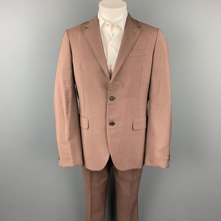 PRADA suit comes in a brown mohair / wool with a full liner and includes a single breasted, two button sport coat with a notch lapel and matching flat front trousers. Moderate discoloration. Made in Italy.  Good Pre-Owned Condition. Marked: IT 48 R