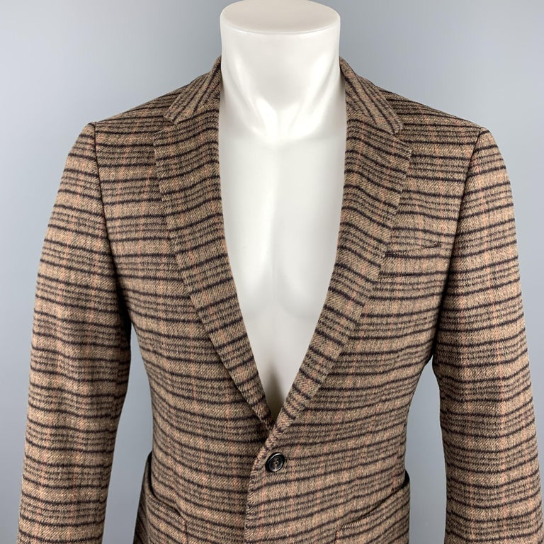 PRADA sport coat comes in a brown plaid lana wool / alpaca featuring a notch lapel style, patch pockets, and a two button closure. Made in Italy.  Excellent Pre-Owned Condition. Marked: 48 R  Measurements:  Shoulder: 15.5 in.  Chest: 38 in.  Sleeve: