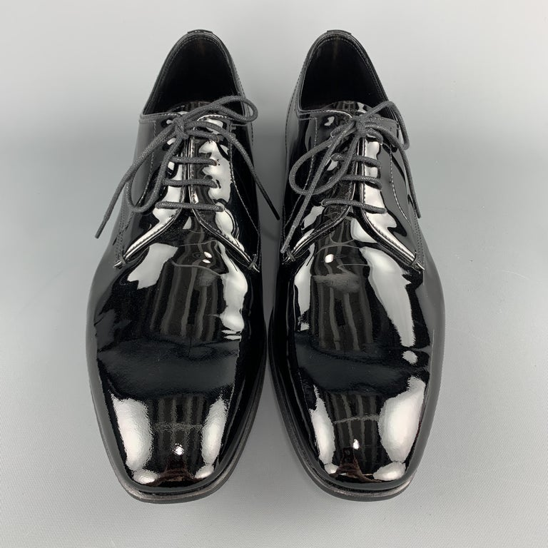 PRADA dress shoes come in black patent leather with a tapered toe and lace up front. With box. Made in Italy.  Excellent Pre-Owned Condition. Marked: UK 8.5  Outsole: 11.5 x 4 in.