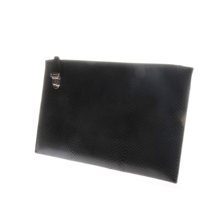 Prada black snakeskin-look leather document holder-type clutch/pouch. Silver-tone hardware with zipper closure to single compartment and branded push lock closure.