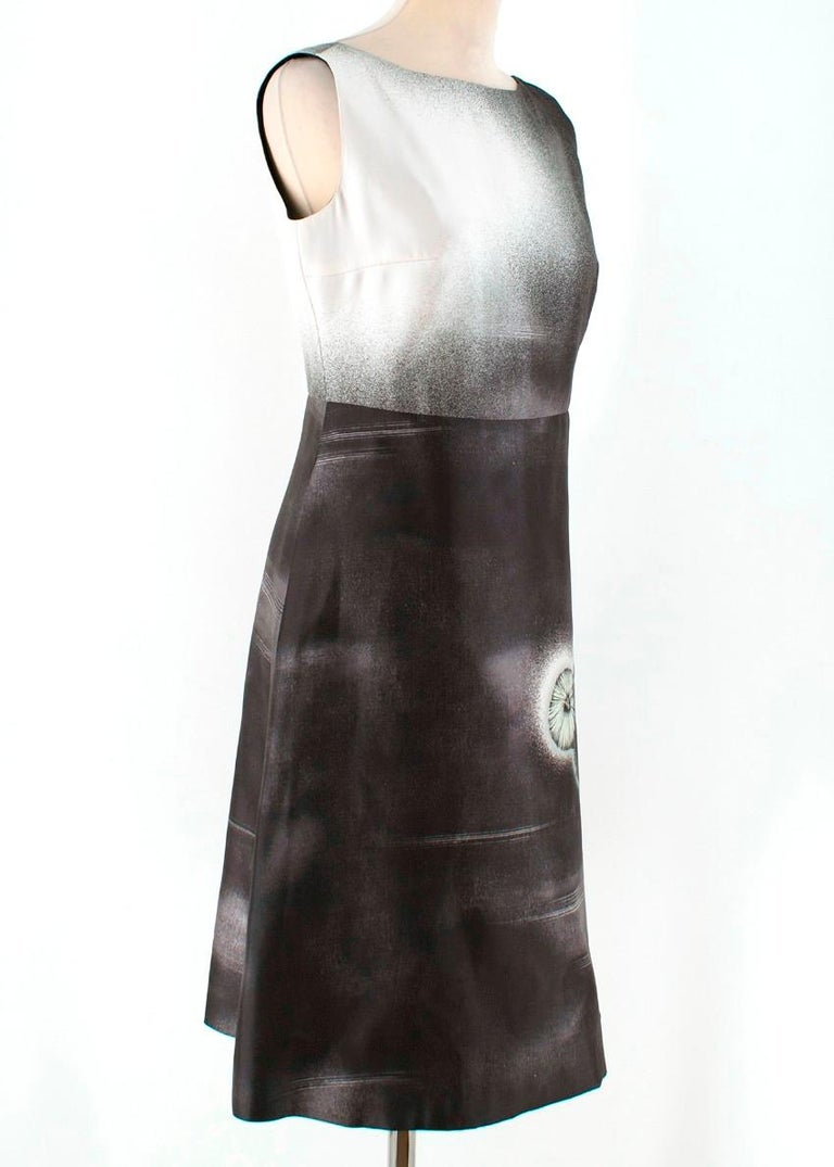 Prada Special Edition Black and White Printed Silk Dress  -Black and white printed dress -Features dandelion head print -Low back -Tailored around the bust and waist -Back zip closure -Knee length  Please note, these items are pre-owned and may show