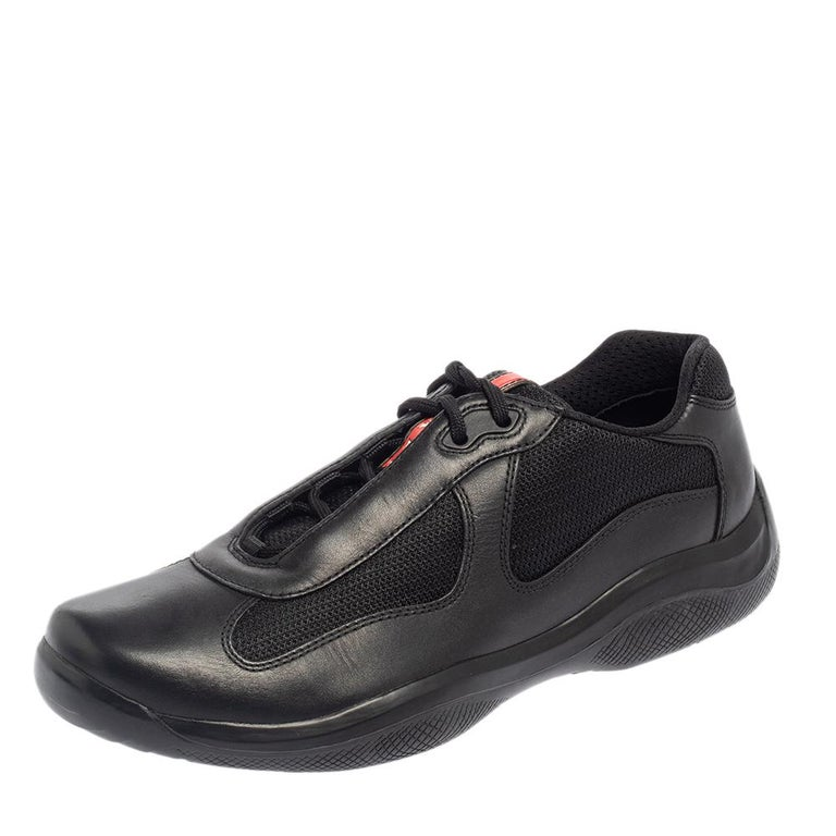 These sneakers from the house of Prada Sport are perfect for those adventure trips or excursions. It features a black leather body accented with mesh panels. Complete with lace-ups, this pair is a must-have for your casual closet.