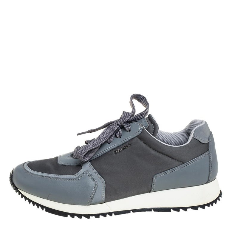 Refuse to compromise comfort with style and opt for this pair from Prada Sport as it has been purposely built to help you look stylish and ease your feet. Crafted from nylon and leather, the sneakers carry a low-top silhouette. Complete with laces