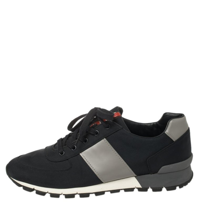 Project a stylish look every time you step out in these Match Race sneakers from Prada Sport. They are crafted from fabric and leather and styled with lace-ups on the vamps and brand logo details on the tongues and the counters. They are equipped