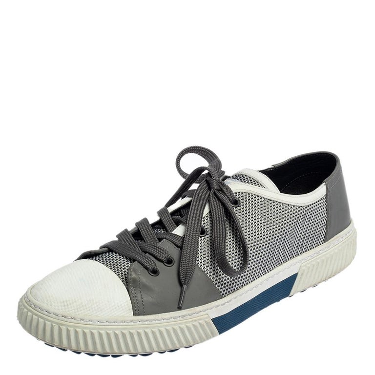 A seamless blend of comfort, luxury, and style, these Prada Sport sneakers are essential for your shoe closet. They have been made from nylon and rubber in two hues. The trainers are finished off with laces. round toes, and sturdy outsoles.