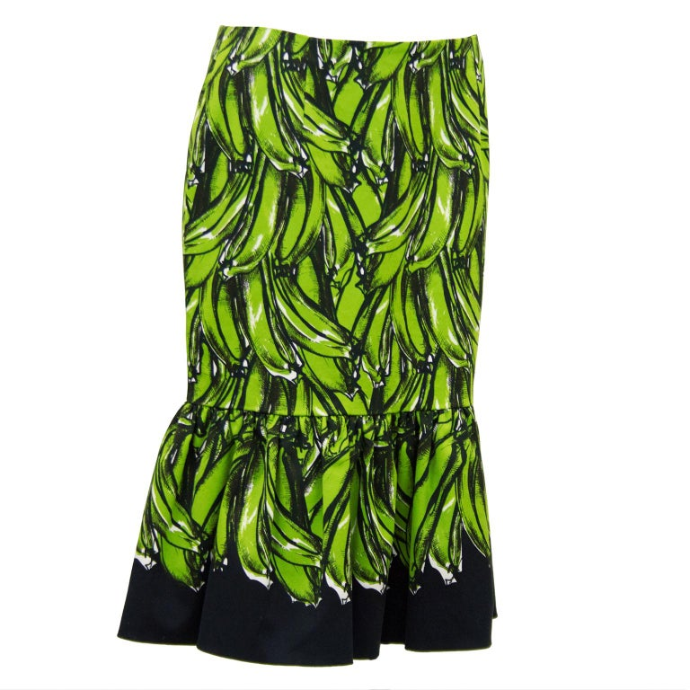 Featured on the runway for the Prada 2011 Spring RTW show and on the pages of fashion magazines and waists of the fashion elite, this cotton fluted pencil skirt is a iconic piece of fashion. Features an all over print of green bananas on a black