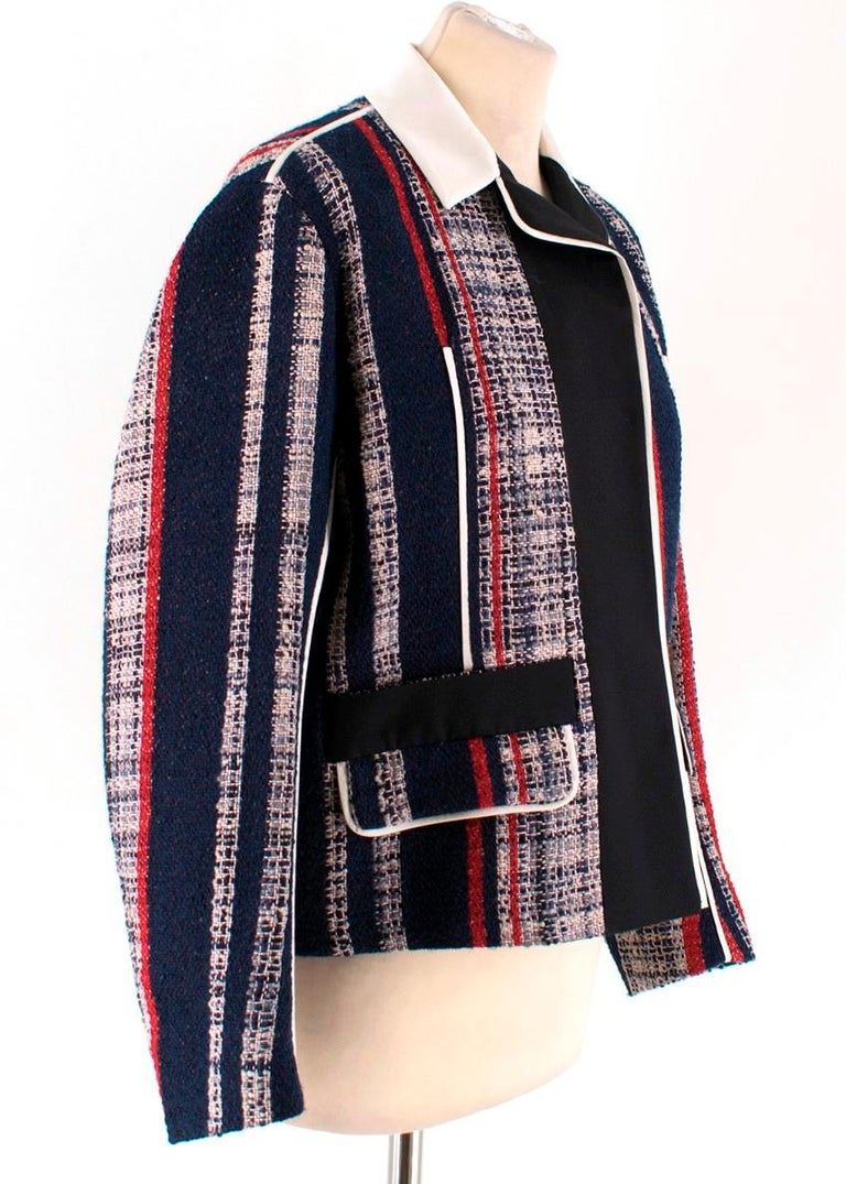 Prada Striped Tweed Jacket  - Tweed jacket crafted in a blend of wool, cotton and silk - Striped patterning in shades of blue, red and white - Black silk-blend lining - White silk & wool-blend collar and trim piping - Front flap pockets - Long