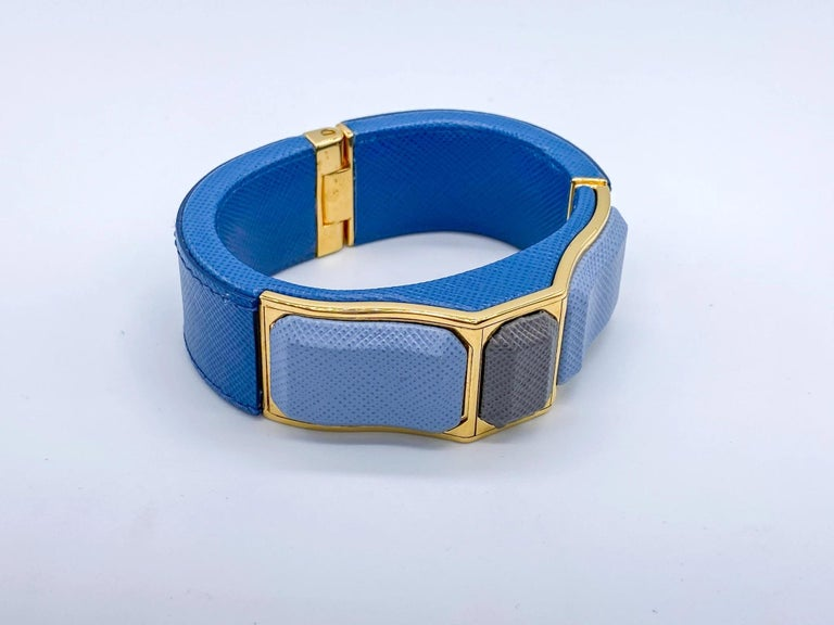 Prada Vintage Blue Leather Cuff Bracelet   Fantastic statement leather bracelet from the House of Prada Spring 2014 collection  Detail -Made in Italy from saffiano leather -High shine gold coloured hardware -Push button hinged closure for easy on
