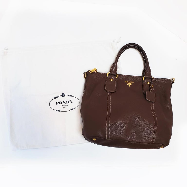 Brand - Prada Collection - Vitello Daino Estimated Retail - $1,700.00 Style - Satchel Material - Leather Color - Brown Pattern - Shopper Closure - Zip Hardware Material - Goldtone Comes With - Dustbag Size - Extra Large Feature - Detachable