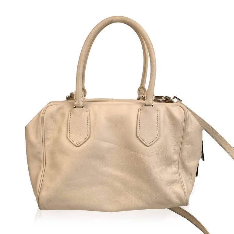 Prada 'Inside bag' from the 2015 Fall/Winter collection. Crafted in soft white leather with light blue leather interior mock twin bag. Double top handles and an adjustable and removable shoulder strap. Silver metal 'Prada Milano' lettering on the