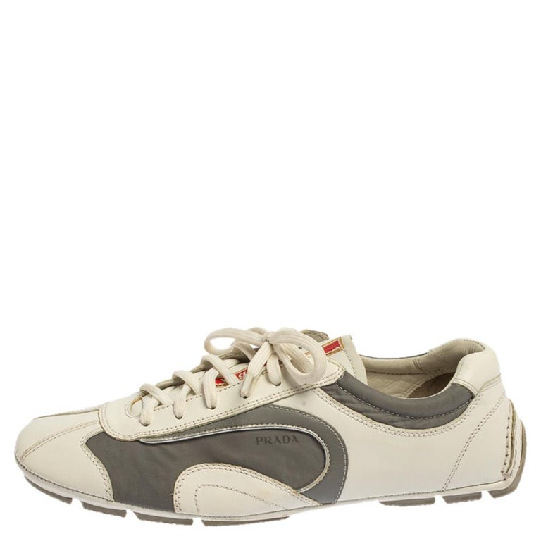 This is a pair of nylon and leather sneakers that add sophistication to your ensemble. Equipped with rubber soles, sneakers are the staple of any wardrobe. Flaunt a stylish look every time you head out wearing these sporty Prada sneakers.