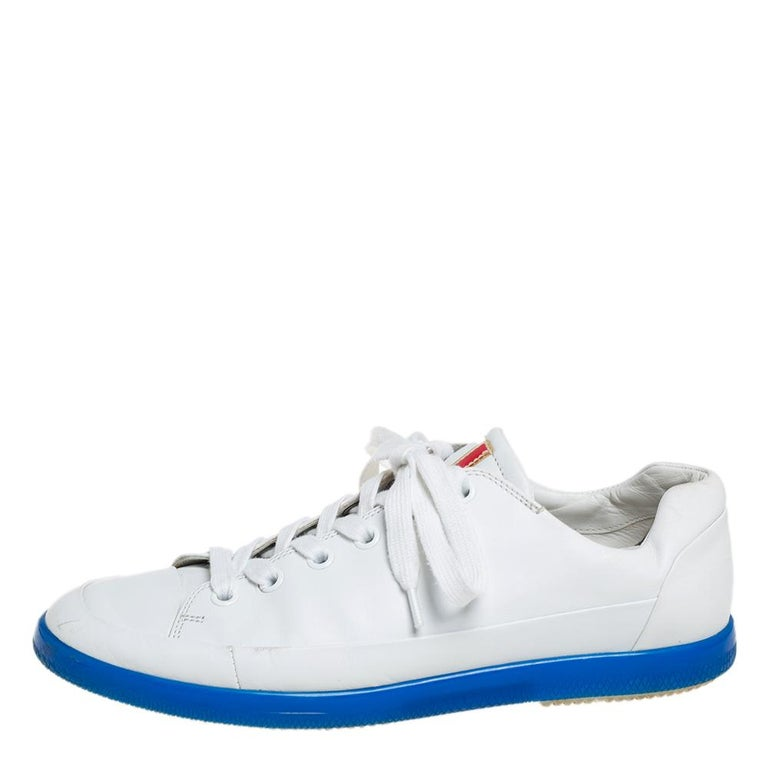 These Prada sneakers come in a classic style and silhouette that makes them highly covetable. Made from white leather, they come with laced-up vamps, round cap toes, and comfortable insoles.