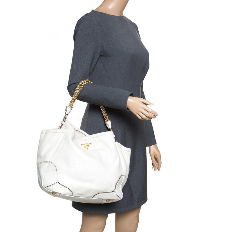 beeea2489754db This shimmering white chain hobo is yet another Prada masterpiece. Crafted  from white deerskin leather