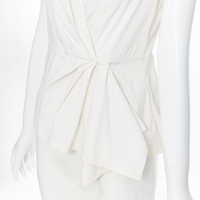 PRADA white stretch cotton draped pleated crossover sleeveless top IT42 Brand: Prada Designer: Miuccia Prada Model Name / Style: Draped top Material: Cotton blend Color: White Pattern: Solid Closure: Zip Extra Detail: Draped pleated detailing.