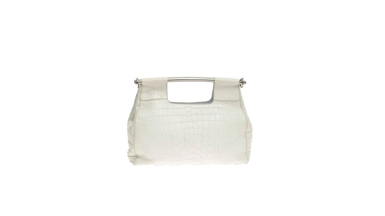 A stunning Prada Alligator Skin Handbag Finest white mat soft exotic skin - no print Prada Triangle logo on side Fully lined One zipped inner pocket Metal bar handel Made in Italy Comes with authenticity card and dustbag