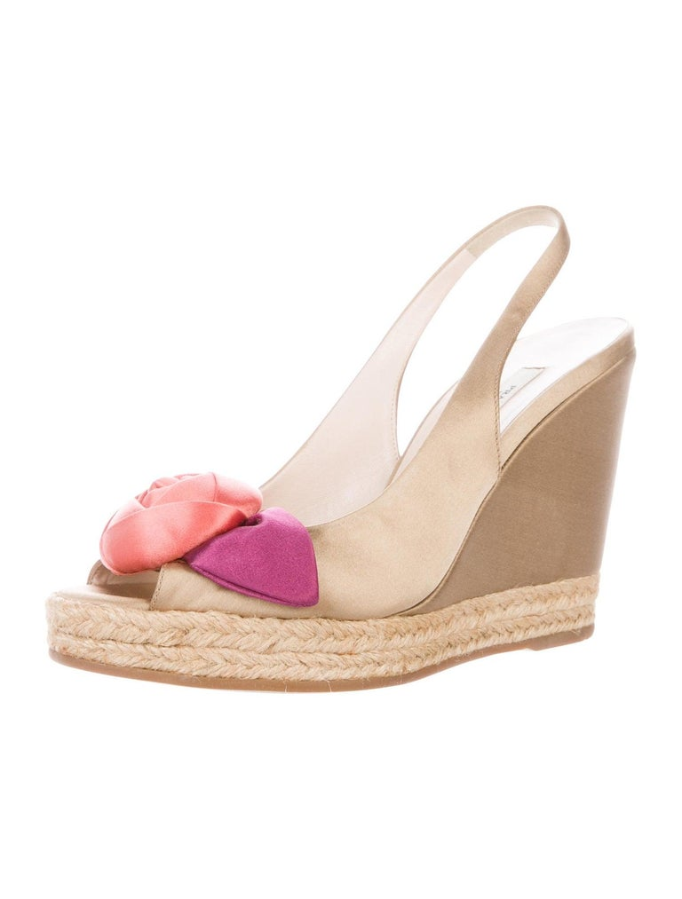 A PRADA signature piece and timeless classic that will last you for years    Beautiful wedge sandal  Caramel satin with pink & coral flower detail So versatile and stylish     Size 38 EU     Made in Italy     Brandnew and unworn, comes with