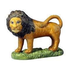 Prattware Pottery Figure of a Lion on a Grass Base, 19th Century