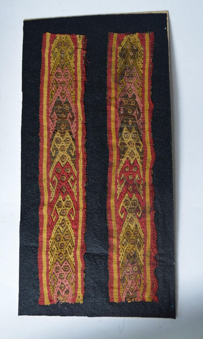 Fine Pre columbian Chancay textile panels  The finely woven textile strips with interlocking mythological figures   probably from a tunic or manta cloth  Chancay circa 1100-1400 AD, Peru.  Mounted on black wool cloth in a modern frame  Size: 14 x 2