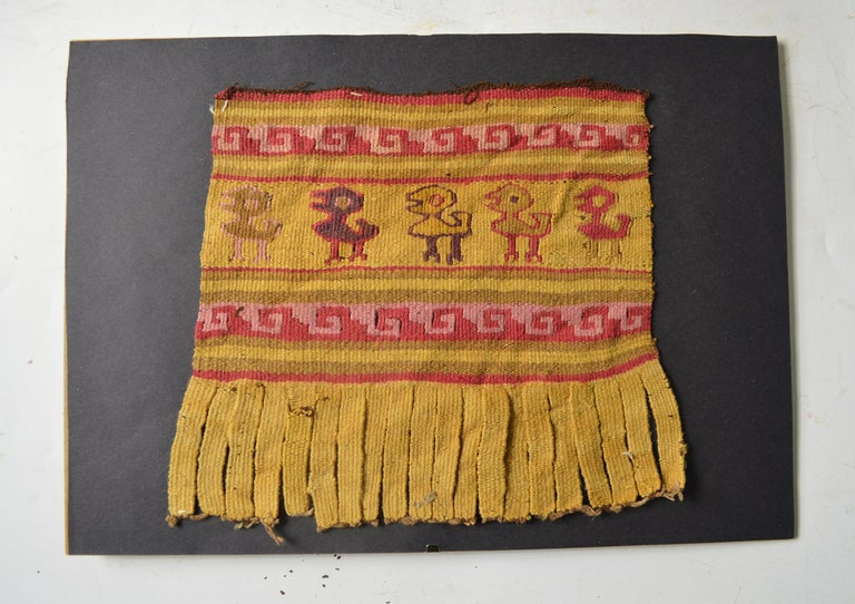 Pre columbian Chancay textile panel   The finely woven textile with birds and temple step design, excellent color preservation  probably from a tunic or manta cloth  Chancay circa 1100-1400 AD, Peru.  Presented in a clip frame  Size: 7 x 6