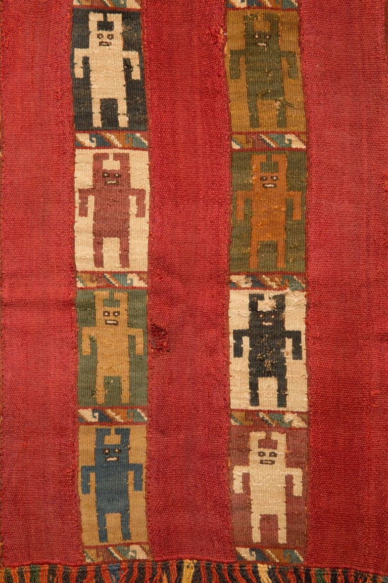 Inca Mantle with 16 figures in cubist form with multi-color fringes. This pieces with a Certificat de Bien Culturel from France.   For the Incas finely worked and highly decorative textiles came to symbolize both wealth and status, fine cloth