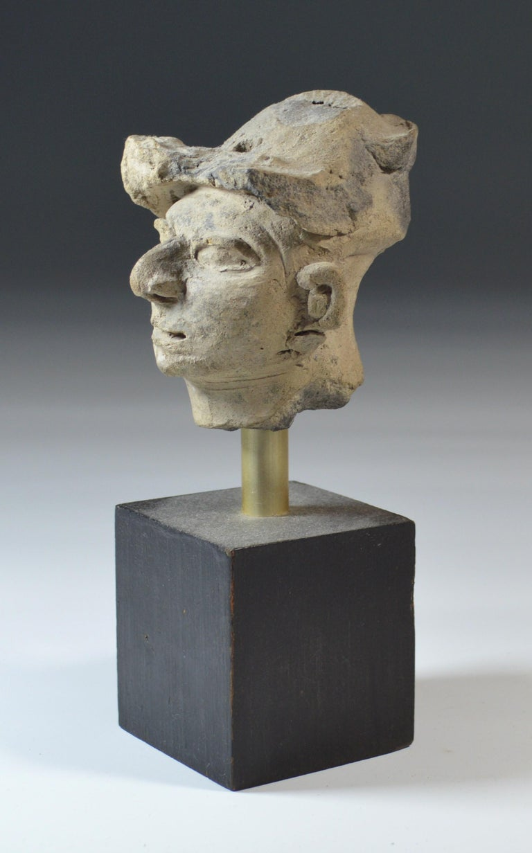 Pre Columbian La Tolita / Tumaco pottery head circa BC 200 Ecuador/ Columbia A striking very finely modeled grey pottery head with a very expressive face with turban type headdress somewhat reminiscent of a European classical period sculpture. Size
