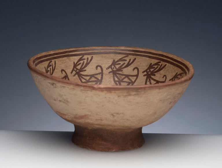 Fine Pre-Columbian Narino footed bowl, circa 850 to 1500. Bowl depicts deer image with alternating eight pointed star symbol, most likely Venus.