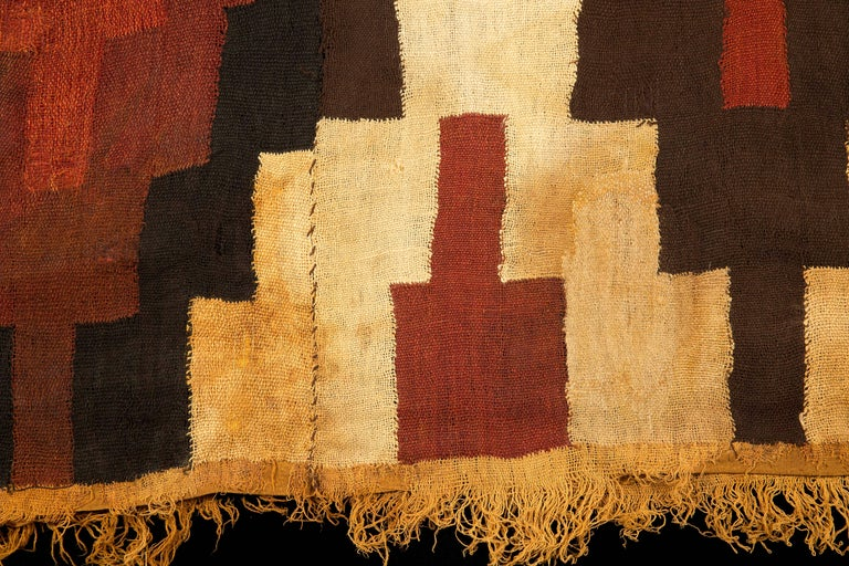 Nazca Tunic/Poncho of stepped design and fringe in yellow ocher, burgundy and brown. Perfect condition, museum quality.