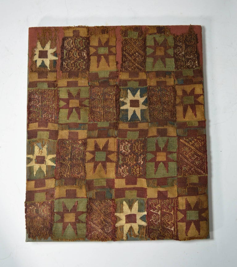 Pre-Columbian art. A rare Inca textile fragment panel ancient South America. The textile finely woven with multi color star motives interspersed with piranha fish, birds and animals in bands of red, probably from a tunic or manta cloth Inca