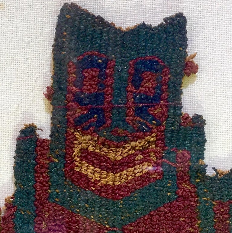 Magnificent Pre-Columbian Paracas textile fragment depicting a shaman warrior with a trophy head on his right hand. Framed and professionally sewn onto a beige linen cloth. Camelid fibers.  Provenance: Private French collection  Dimensions with