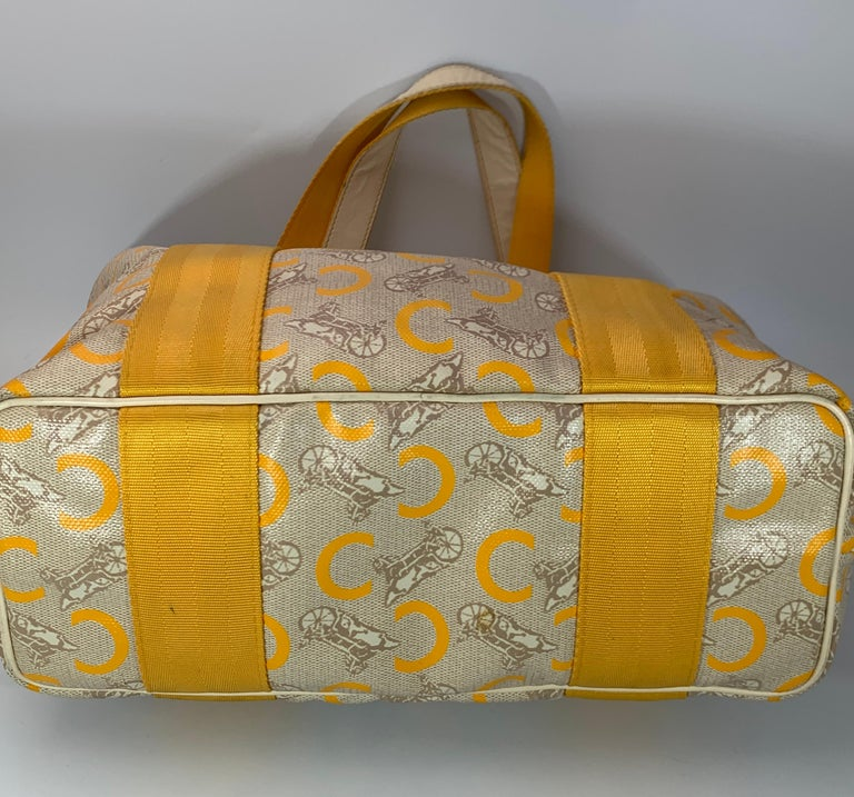 Celine Yellow  Beige  Canvas Coated PVC Plastic Macadam Tote Bag  Bag is in Excellent condition Inside is Beige canvas , Very Clean , Zippered Hanging pocket with slip pockets. Measurements Length 12