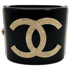 Pre-loved Chanel Gold & Black Resin CC Logo Cuff 2016 Collection