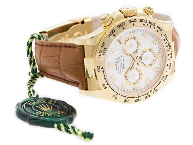 18K Yellow Gold Rolex Daytona 116518 watch, water resistance to 100m, with diamond dial, chronograph, tachymeter, and leather strap. Comes with Rolex Hangtag.  Watch	 Brand:	Rolex Series:	Daytona Model #:	116518 Gender:	Men's Condition:	Excellent
