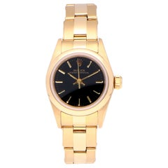Pre-Owned Rolex Oyster Perpetual 18 Karat Yellow Gold 67188 Watch
