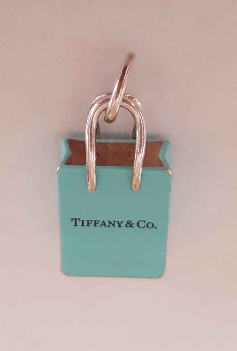 Women's or Men's Pre-Owned Tiffany & Co. Silver Signature Blue Purse Pendant, Enamel Finish For Sale